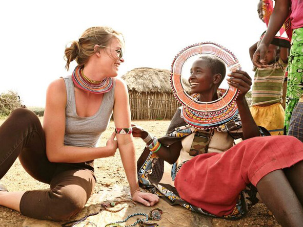 Travellers interacting with local Kenyans