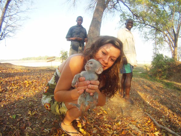 Candice McCarthy - saying hello to a little monkey in Malawi