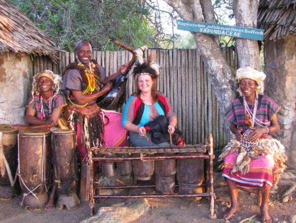 Gelle Ritchie - drumming with the locals in Kenya