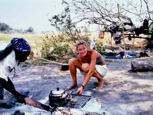 Ingrid de Wet - cooking on the coals in the Okavango Delta