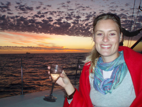 Kate Erskine - on a catamaran enjoying a beautiful Cape Town sunset