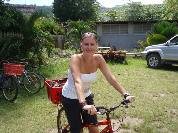 Kate Erskine - riding a bike in the Seychelles