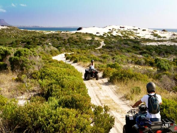 Mosaic - enjoy a thrilling quad biking excusion over the dunes to the beach
