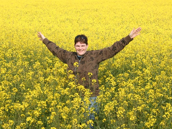 Ramona Rubach - playful in a field of canola in the Western Cape