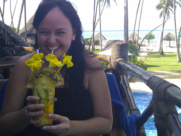 Robyn de Jager - sipping on a colourful cocktail in Zanzibar