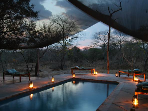 Selous Safari Camp - pool at night