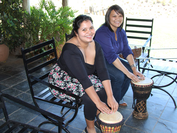 Sharlaine Assur - learning to drum with fellow Safari Expert, Shihaam