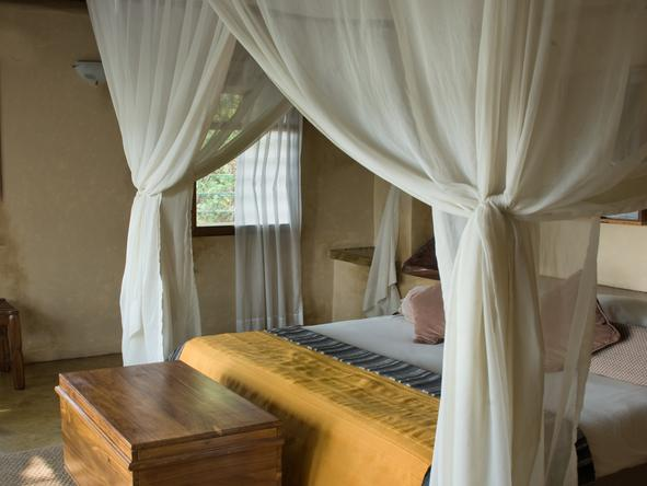 Susuwe Island Lodge - bedroom